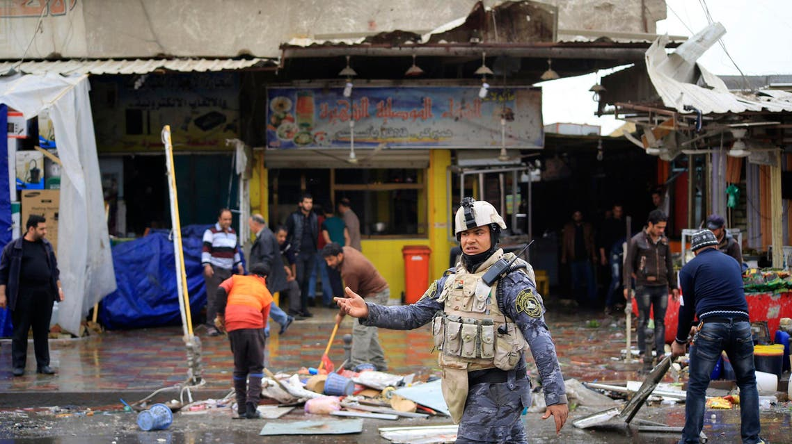 A member of the Iraqi security forces walks past the site of a bomb attack in Baghdad February 7, 2015. (File photo: Reuters)
