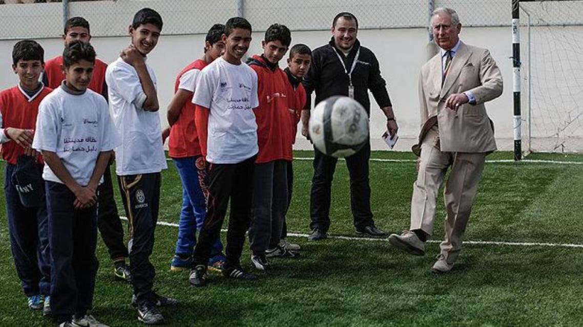 Prince Charles displays his football skills in front of young athletes during a visit to Jordan's Zaatari Camp.(Photo courtesy: Sam Tarling/The Telegraph)