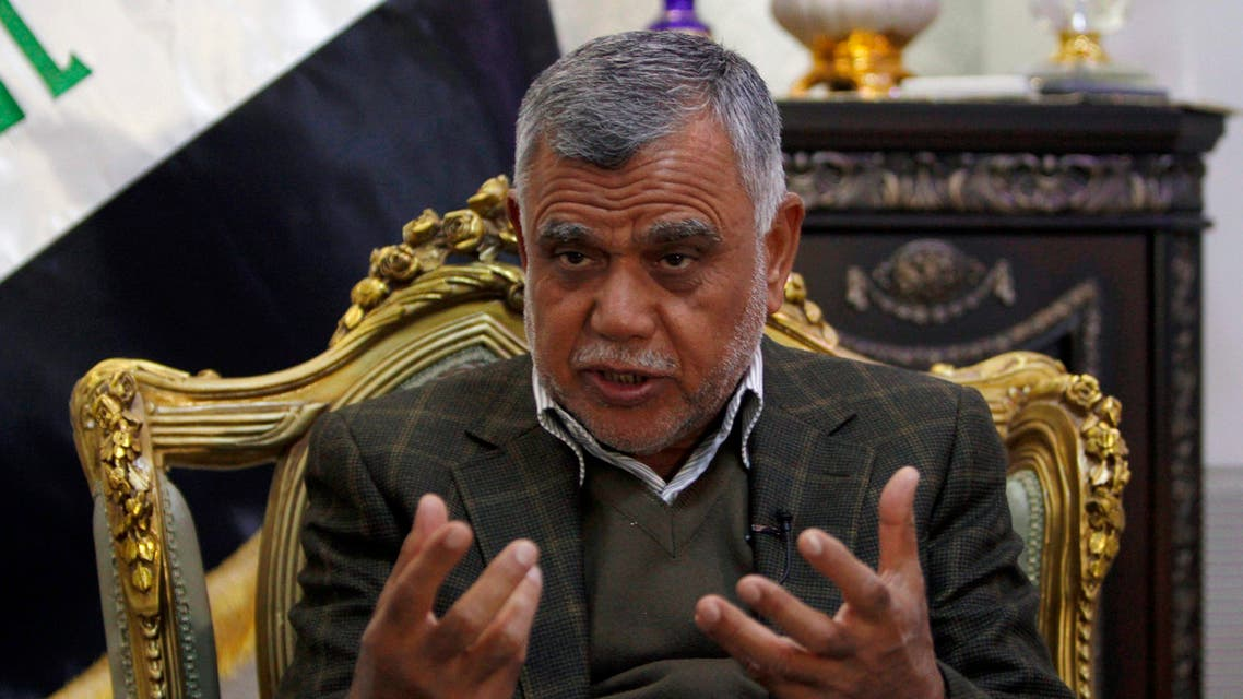 Lawmaker and paramilitary commander Hadi al-Amiri gestures during an interview with Reuters in Baghdad February 6, 2015. (Reuters)