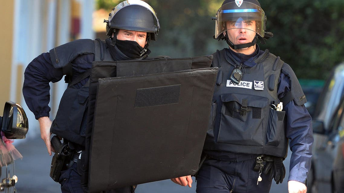 French police officers take up positions during an operation at a housing estate in the French city of Marseille on February 9, 2015. (AFP)
