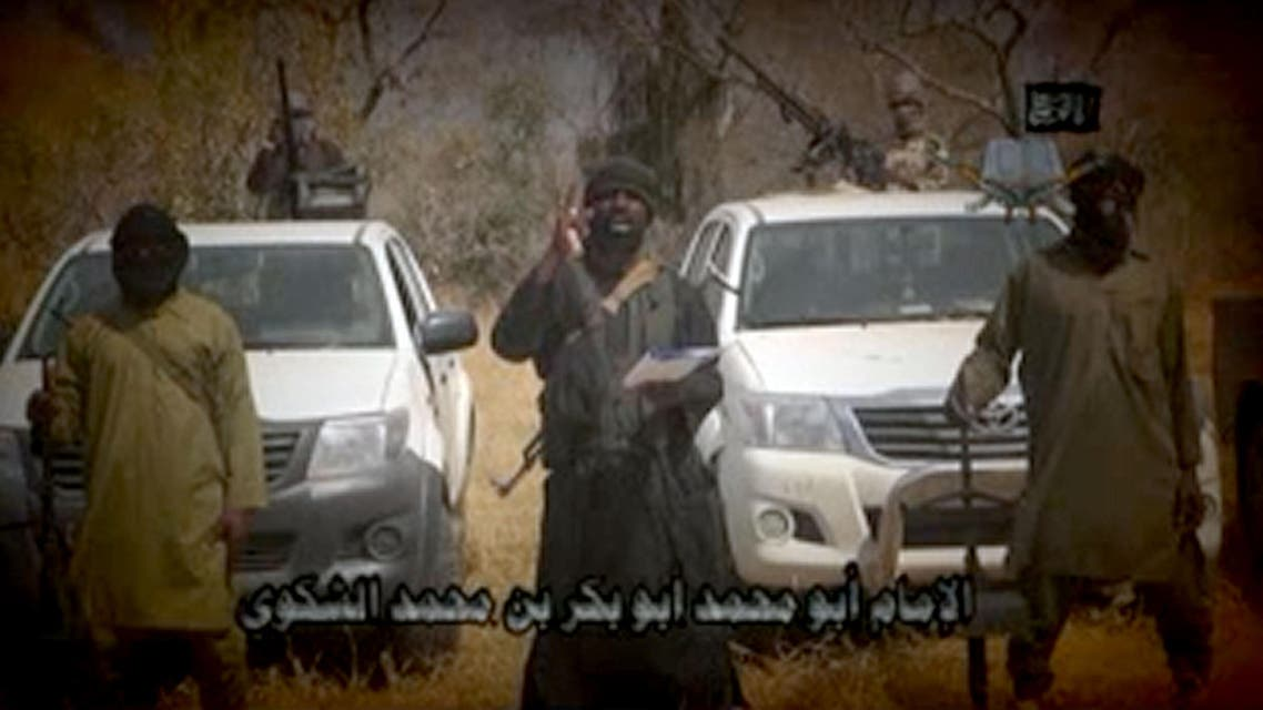 In this screen grab image taken on February 9, 2015 from a video made available by Islamist group Boko Haram, leader Abubakar Shekau (C) makes a statement at an undisclosed location.(AFP)