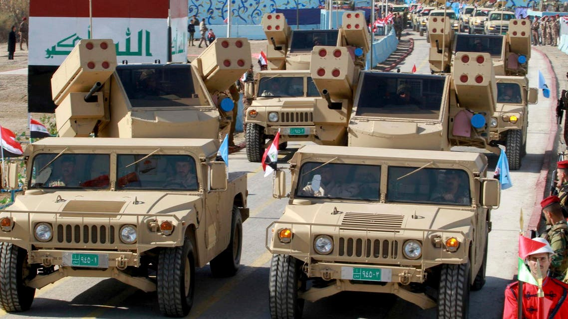 Military vehicles parade during a ceremony marking the anniversary of the founding of the Iraqi Air Defence in Baghdad, February 1, 2015.  (Reuters)