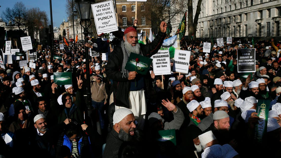 Muslim demonstrators hold placards during a protest against the publication of cartoons depicting the Prophet Mohammad in French satirical weekly Charlie Hebdo, near Downing Street in central London February 8, 2015. (Reuters)