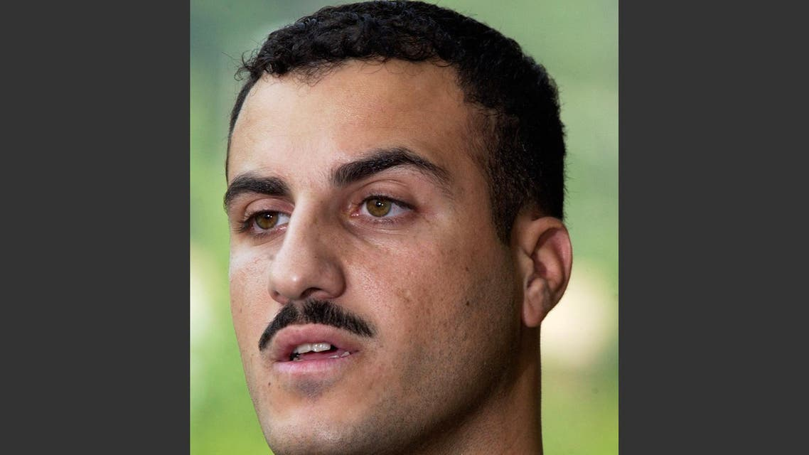 FILE - In this July 19, 2004 file photo, Marine Cpl. Wassef Ali Hassoun makes a statement to the media outside Quantico Marine Base in Quantico, Va. Hassoun, who vanished from his unit in Iraq and later wound up in Lebanon for eight years, will face trial on desertion and other charges, the military said Friday, Sept. 26, 2014. AP