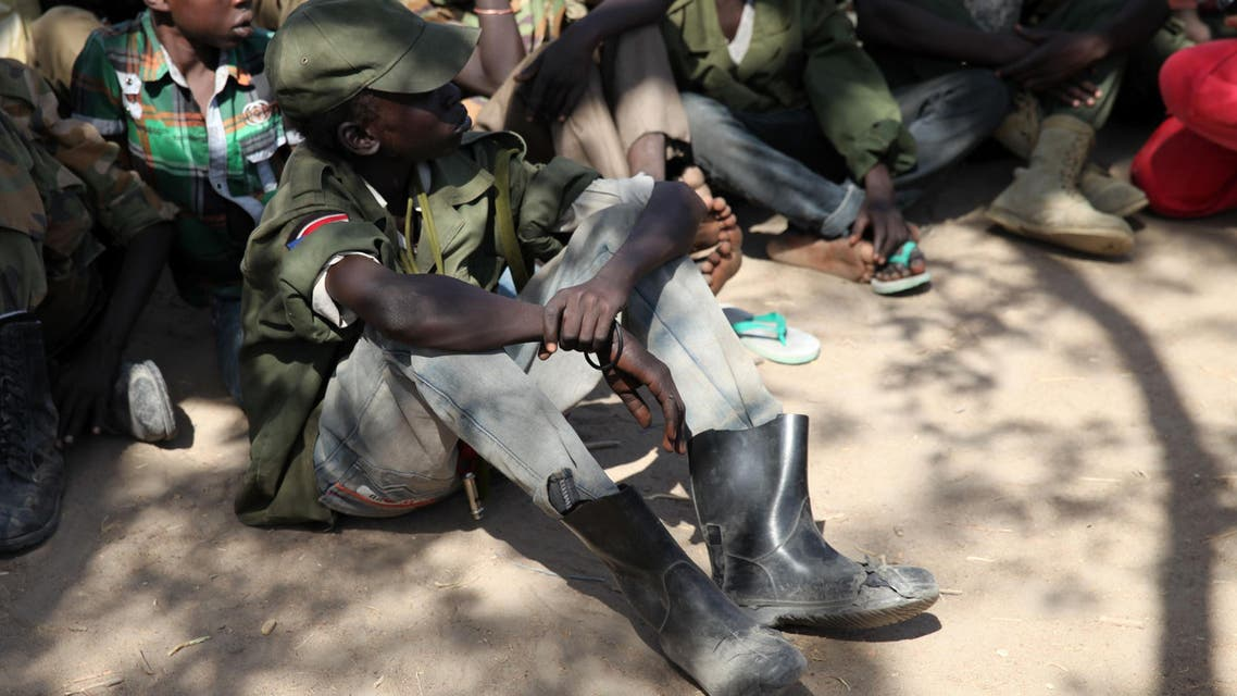 Rebel child soldiers gather in Gumuruk, as they prepare to handover their weapons at a demobilisation ceremony in Jonglei State, eastern South Sudan, Jan. 27, 2015.  (Reuters)