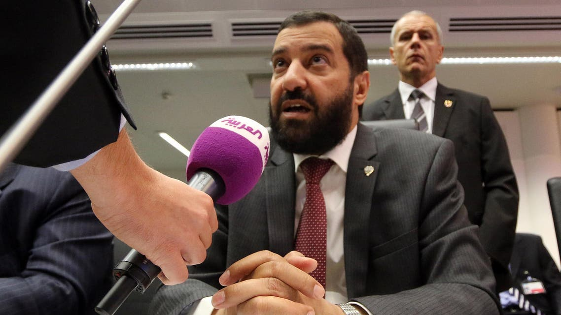 Minister of Oil and Minister of State for the National Assembly Kuwait's Ali Saleh Al-Omair speaks to journalists prior to the start of a meeting of the Organization of the Petroleum Exporting Countries, OPEC, at their headquarters in Vienna, Austria, Thursday Nov. 27, 2014. (AP)