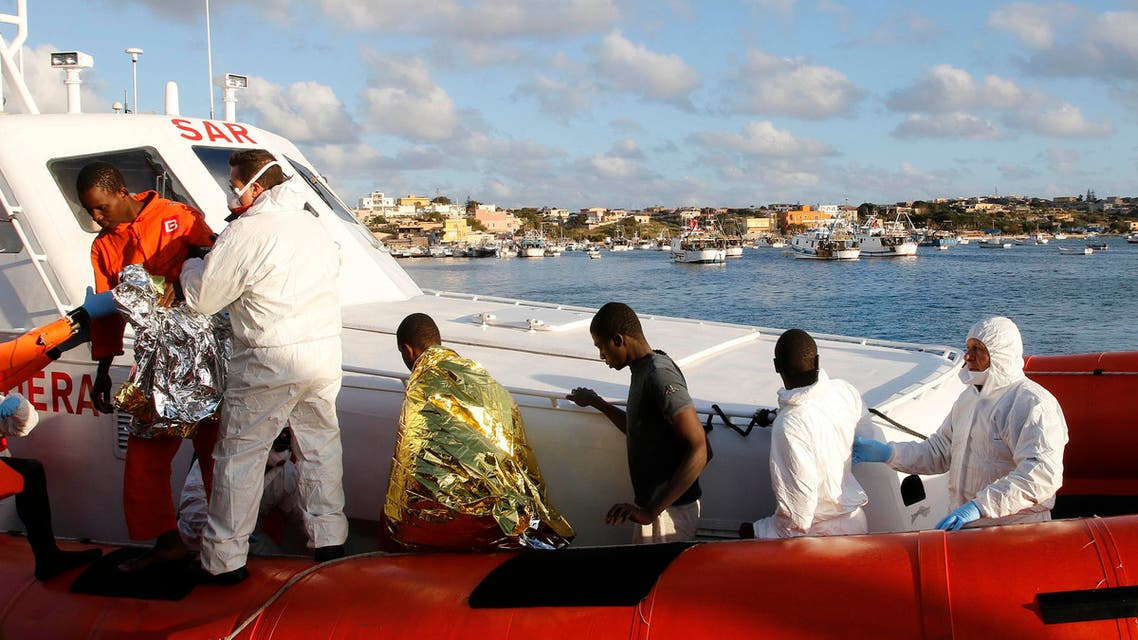 Migrants who survived a shipwreck arrive at the Lampedusa harbour February 11, 2015. An Italian tug boat rescued 9 people who had been on two different boats on Monday and brought them to the Italian island of Lampedusa on Wednesday morning. (Reuters)