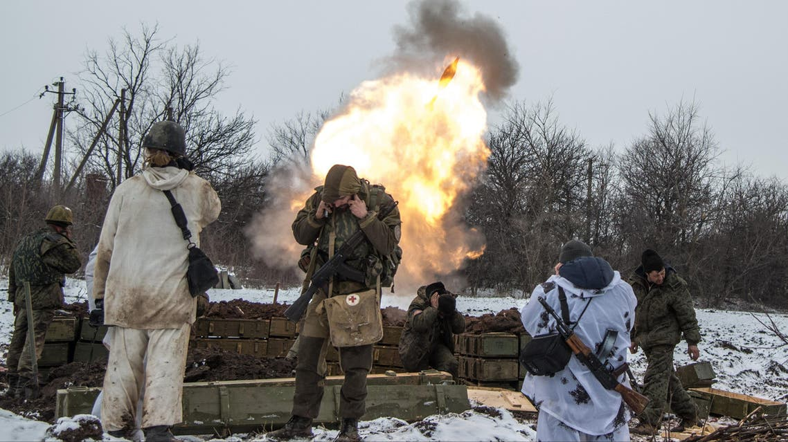Russian-backed separatists cover their ears as they fire a mortar towards Ukrainian troops outside the village of Sanzharivka, northeast of Debaltseve, eastern Ukraine, Wednesday, Feb. 11, 2015.(AP)