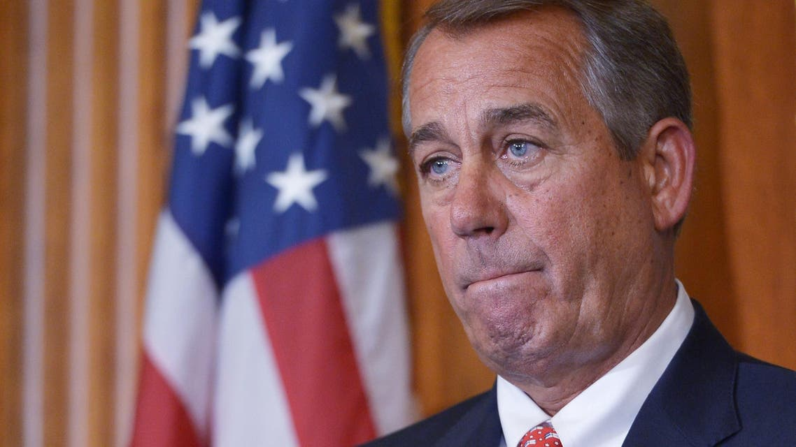 """House Speaker John Boehner, R-OH, listens to a speaker during the signing ceremony for H.R.203, the """"Clay Hunt Suicide Prevention for American Veterans Act."""" AFP"""