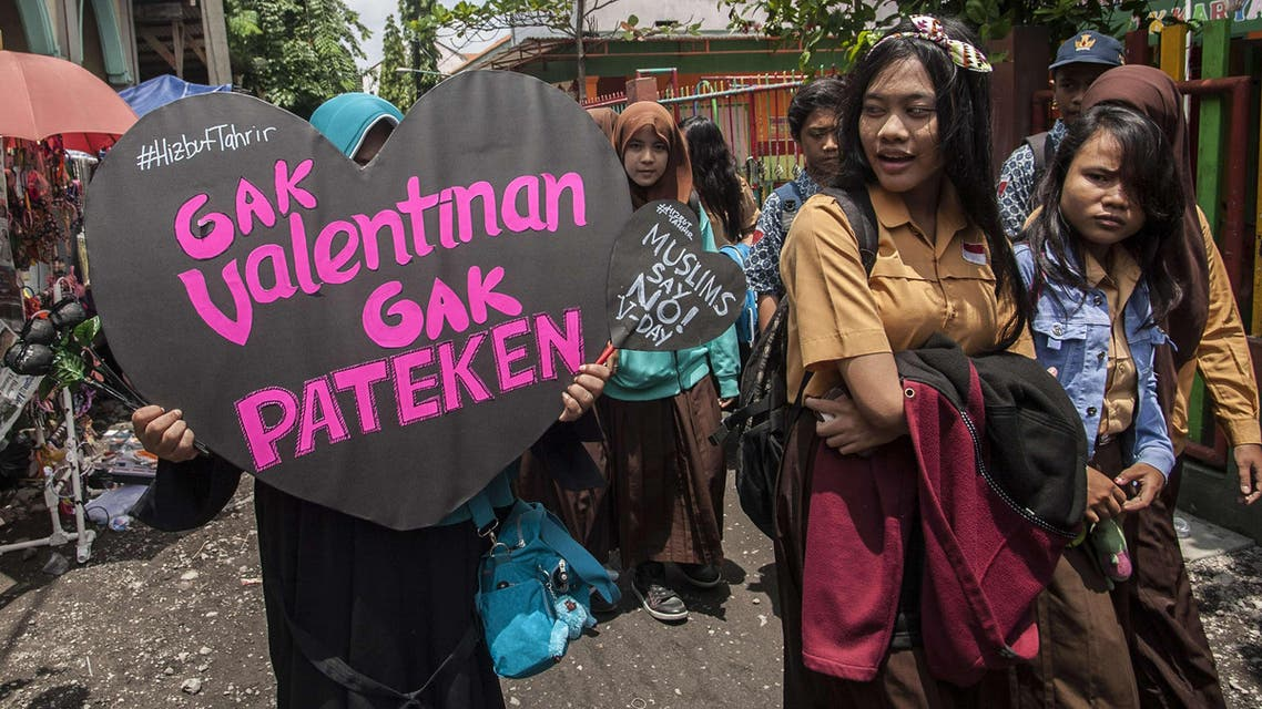 A member of Indonesia's conservative Islamic organization Hizbut Tahrir holds a placard during an anti-Valentine's Day protest outside a school in Surabaya city, eastern Java island on February 13, 2015. (AFP)