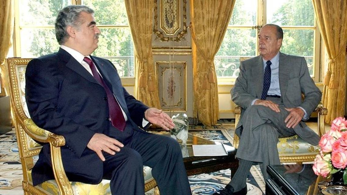 French President Jacques Chirac, right, and Lebanese Prime Minister Rafik Hariri chat during their meeting at the Elysee Palace in Paris Friday, July 18, 2003.  AP