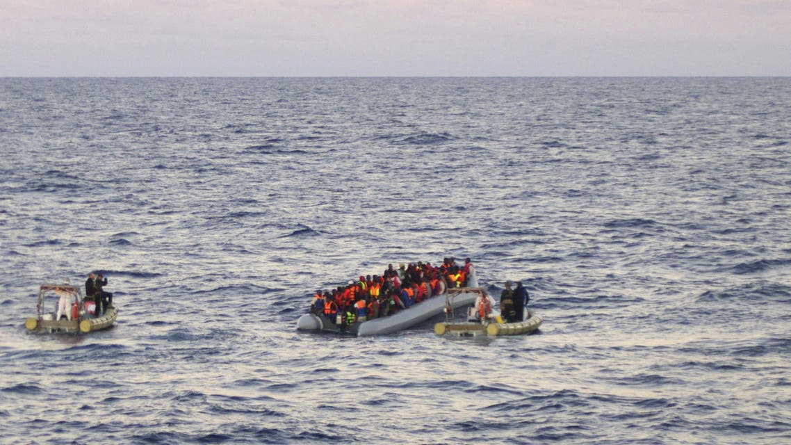 In this file photo taken on Thursday, Dec. 4, 2014 provided by the Italian Navy, rescue crews approach migrants on a rubber boat some 40 miles (65 kilometers) from the Libyan capital, Tripoli. Rescue crews discovered 16 bodies in a migrant boat off Libya, the first reported deaths since the European Union took over Mediterranean rescue operations, the Italian navy said Friday. AP