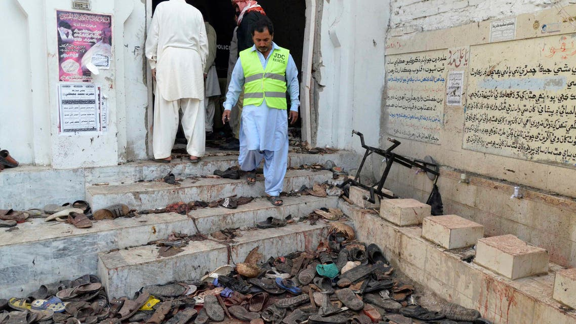 A rescue worker steps outside where victims' shoes are scattered after an explosion in a Shi'ite mosque in Shikarpur, located in Pakistan's Sindh province January 30, 2015. (File photo: Reuters)