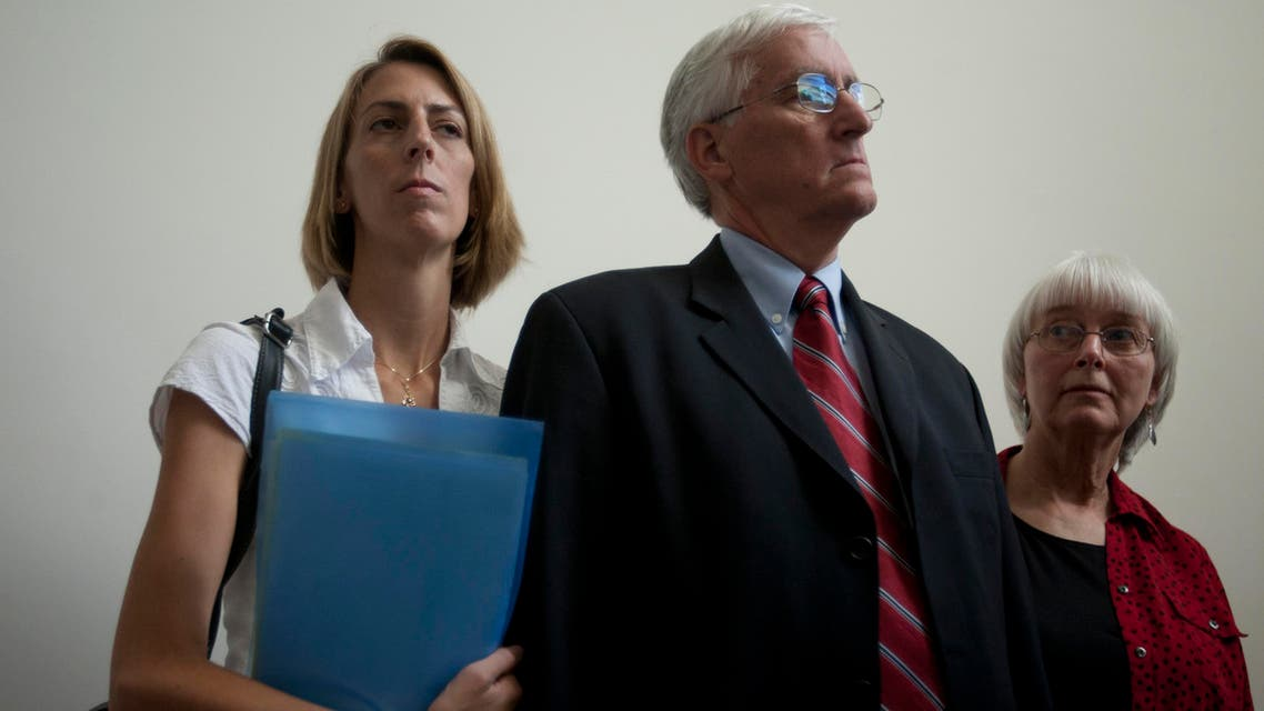 Cindy, right, and Craig Corrie, the parents of Rachel Corrie, a pro-Palestinian activist who was killed by an Israeli bulldozer in Gaza in 2003, stand together with their daughter Sarah after the district court's ruling in Haifa, Israel, Tuesday, Aug. 28, 2012. (File photo: AP)