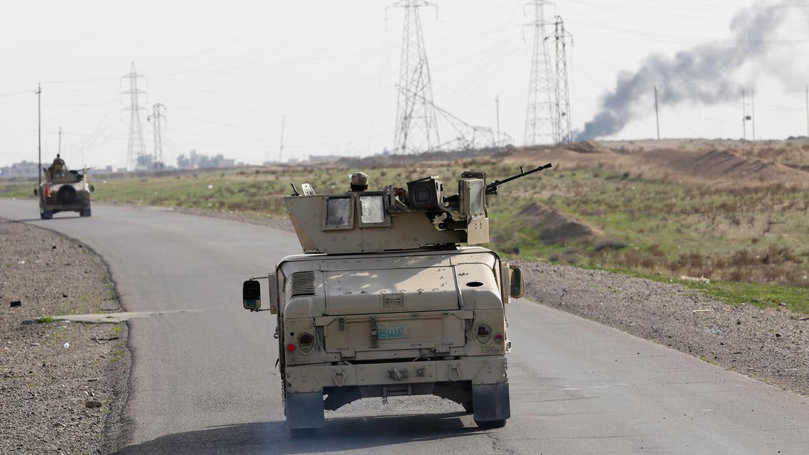Iraqi security forces are deployed during a military operation to regain control of the villages around the town of Beiji, some 250 kilometers (155 miles) north of Baghdad, Iraq, Monday, Dec. 8, 2014. AP