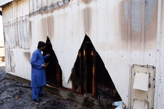 Assistant Imam of the center Ahsan Zahid walks through the burned Quba Islam Institute on Friday morning, Feb. 13, 2015. (Photo courtesy of Cody Duty / Houston Chronicle )