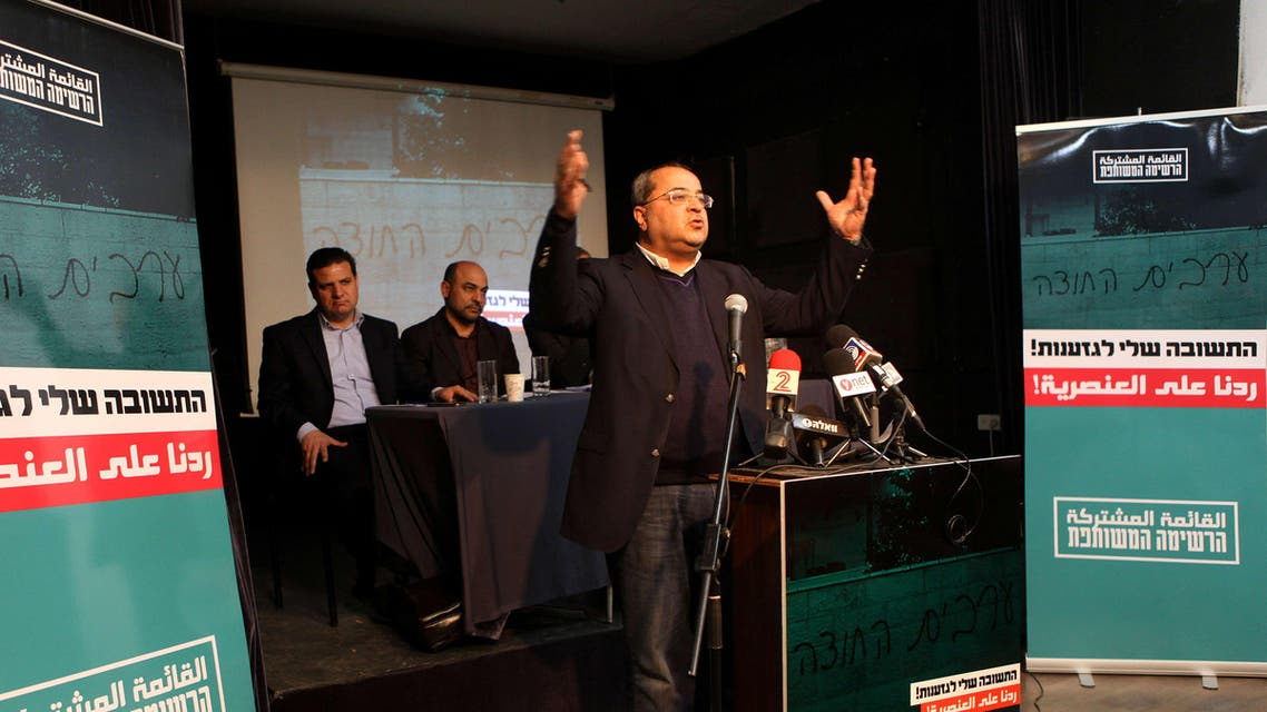 Israeli parliament member Ahmad Tibi delivers a speech as fellow members of the Arab united list for Israel general elections, Israeli-Arab lawyer Ayman Odeh (L), MPs Masud Ghanayem (2nd R) and Jamal Zahalka (unseen) listen during a press conference in Tel Aviv on February 11, 2015. AFP