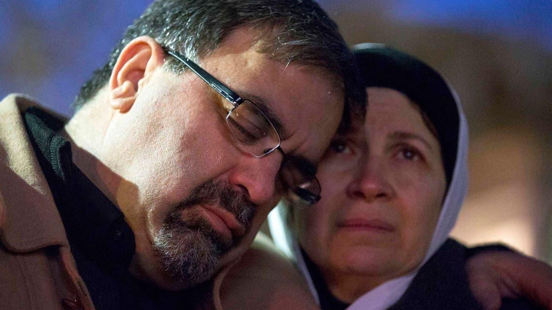 Namee Barakat embraces his wife Layla Barakat, parents of shooting victim Deah Shaddy Barakat, during a vigil in Chapel Hill Reuters