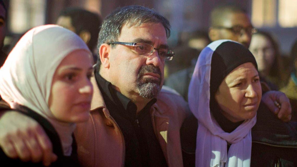 Namee Barakat with his wife Layla (R) and daughter Suzanne, family of shooting victim Deah Shaddy Barakat, attend a vigil on the campus of the University of North Carolina in Chapel Hill, North Carolina February 11, 2015. Reuters