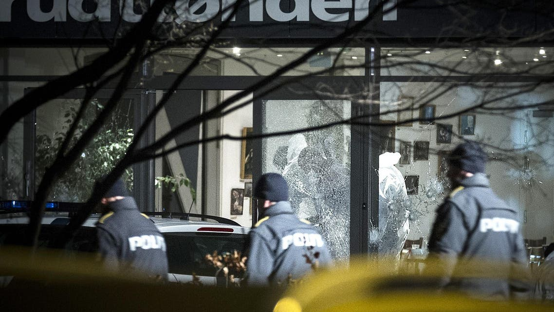 Forensic police officers work at the area around a cultural centre in Copenhagen, Denmark, where shots were fired during a debate on Islam and free speech on February 14, 2015. (AFP)