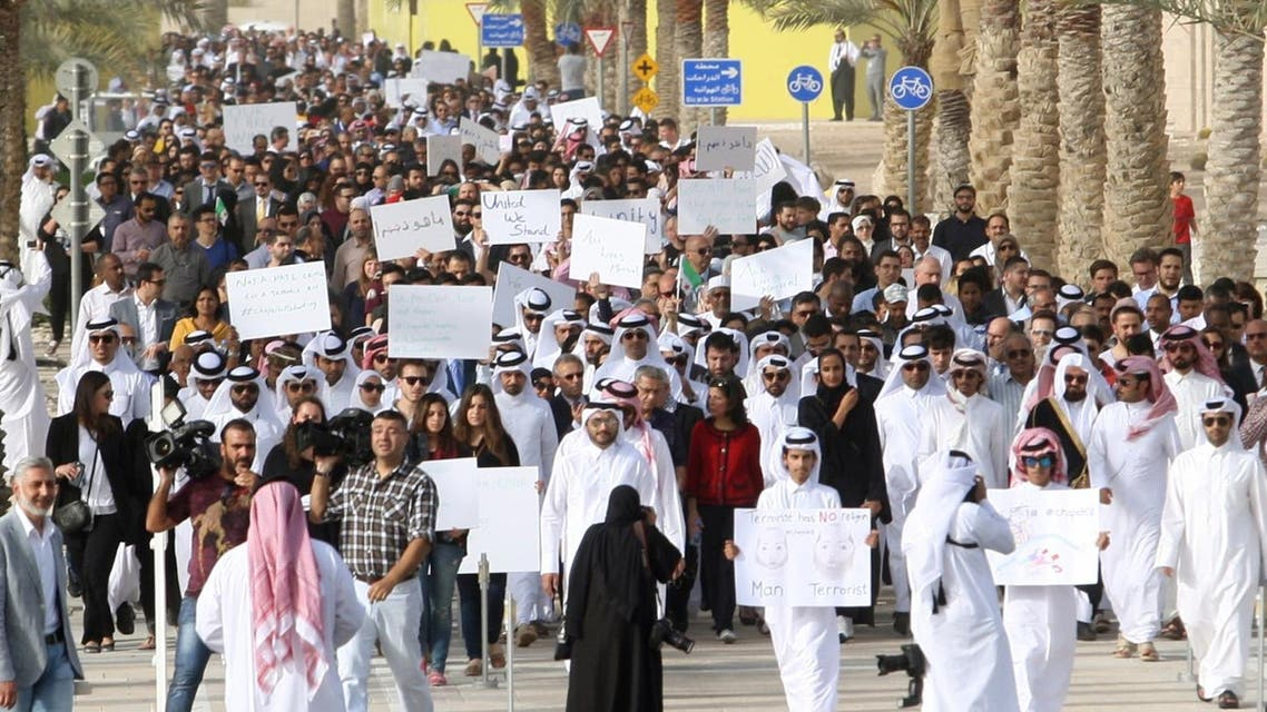 Qataris march down a street in Doha on February 15, 2015, in remembrance of the three victims of the Chapel Hill shooting in the U.S. (AFP)