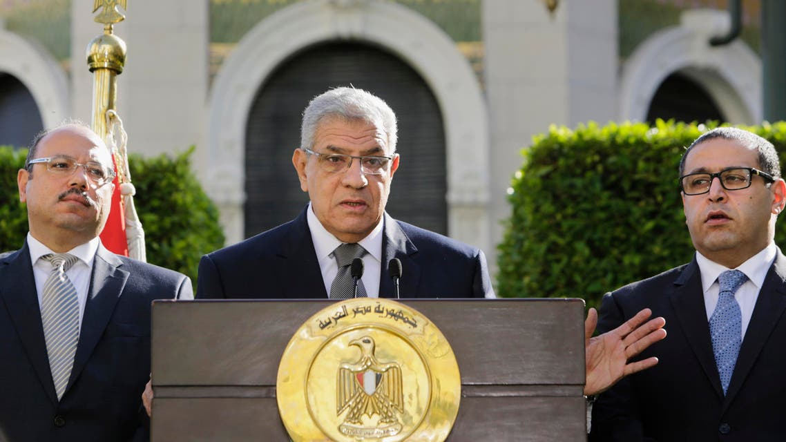Egyptian Prime Minister Ibrahim Mahlab, center, speaks during a press conference in Cairo, Egypt, Saturday, Nov. 22, 2014.  (AP)