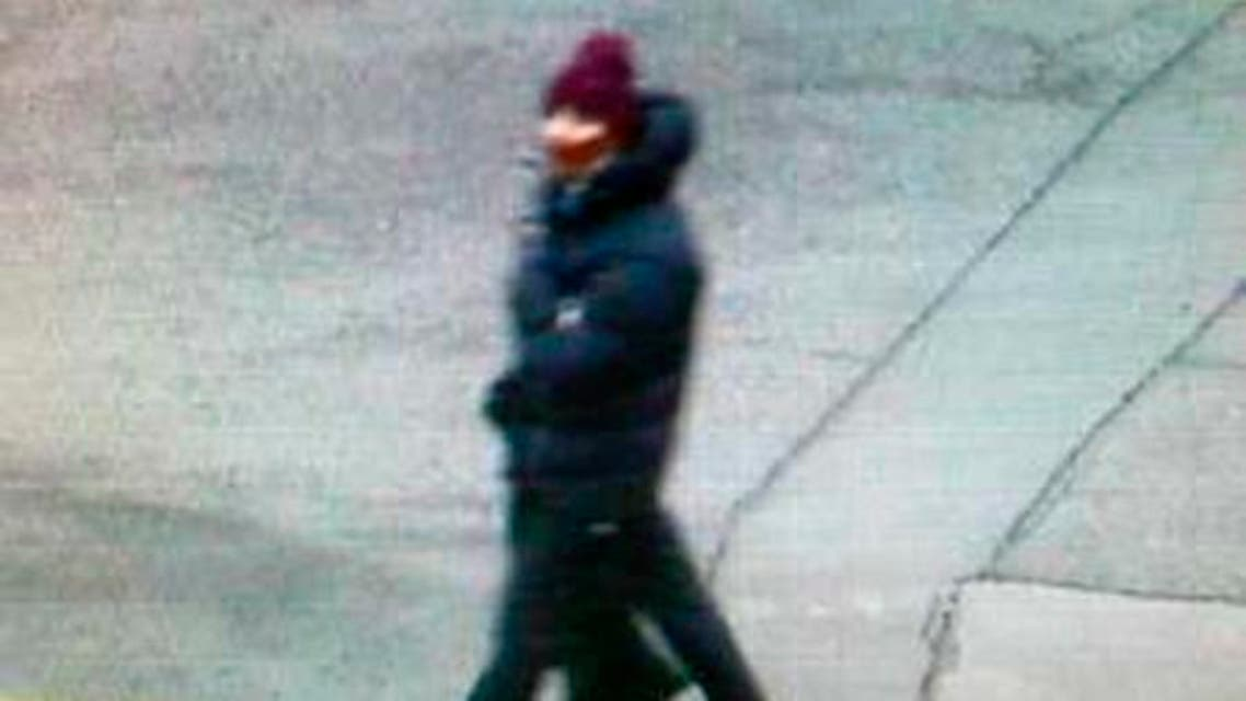 A man who passed a camera in the area shortly after two suspects had fled in a car following a shooting in Copenhagen, is seen in this police still image taken from video shot February 14, 2015. (Reuters)