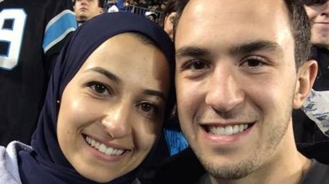 Yusor Abu-Salha and her husband Deah Barakat at an American football match. (Photo courtesy of Twitter)