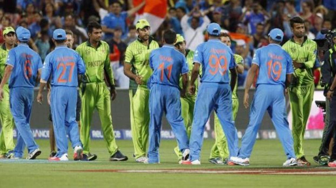 India's World Cup cricket team shake hands with Pakistan's team at the end of their first 2015 World Cup Cricket match n Adelaide, February 15, 2015. (Reuters)