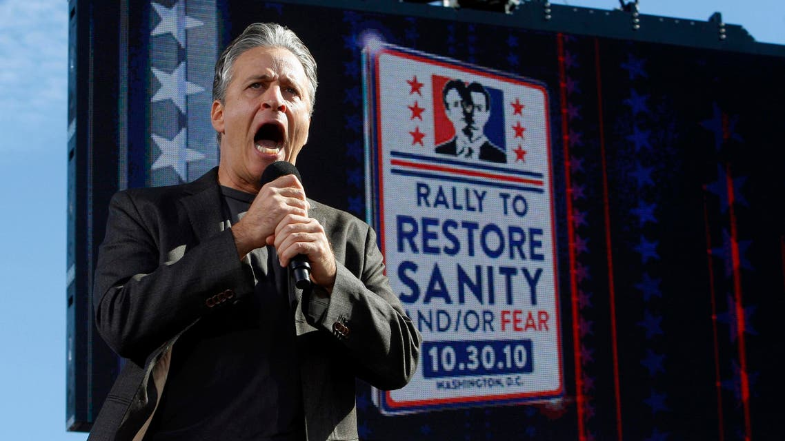 """Comedian Jon Stewart addresses the crowd during his """"Rally to Restore Sanity and/or Fear"""" in Washington, in this file photo taken October 30, 2010. (Reuters)"""