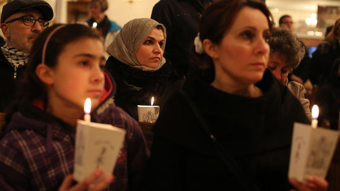 Christian and Muslim Palestinians attend a memorial ceremony in the West Bank of Ramallah on February 17, 2015, for the Egyptian Coptic Christians murdered by Islamic State (IS) group militants in Libya. AP