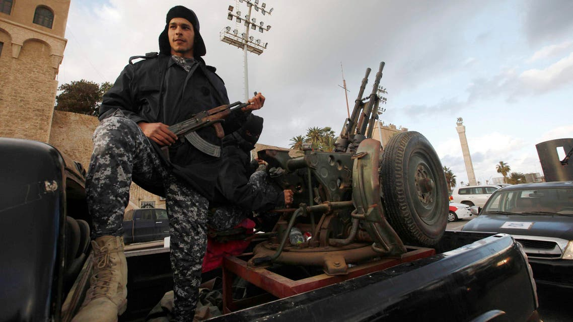Members of the Libyan Police are seen on their vehicles as the Police prepare for deployment during the start of a security plan put forth by the Tripoli-based government to increase security in the Libyan capital, at Martyrs' Square in Tripoli Feb.9, 2015. (Reuters)