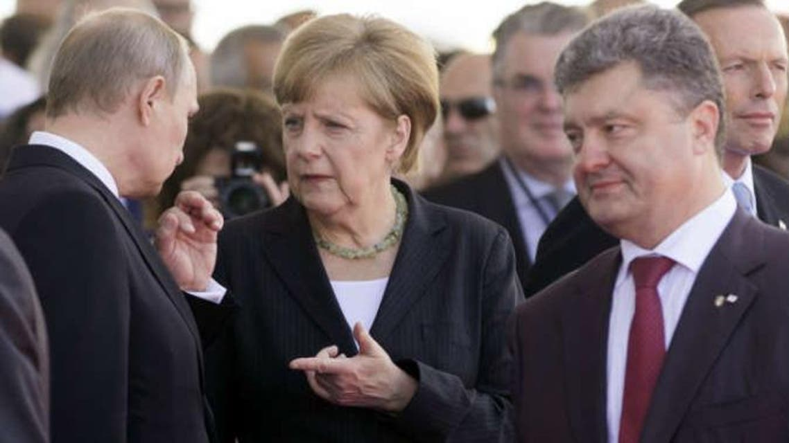 أنجيلا ميركل و فلاديمير بوتين و بيترو بوروشينكو