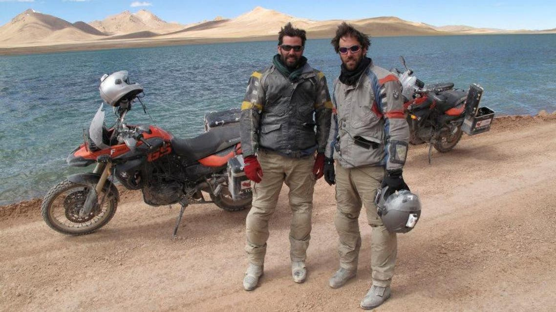 Colin Pyle (left) and Ryan Pyle (right) near a remote glacial lake in Tibet. BMW Motorrad Oakley Touratech.  (Still image from the television series: Tough Rides China with Ryan Pyle and Colin Pyle)