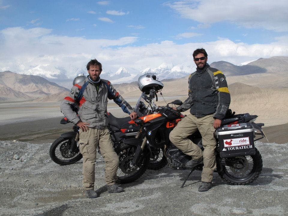 Ryan Pyle (left) and Colin Pyle (right) enjoy the views on the Karakoram Highway in Xinjiang. BMW Motorrad Oakley Touratech. (Still image from the television series: Tough Rides China with Ryan Pyle and Colin Pyle)