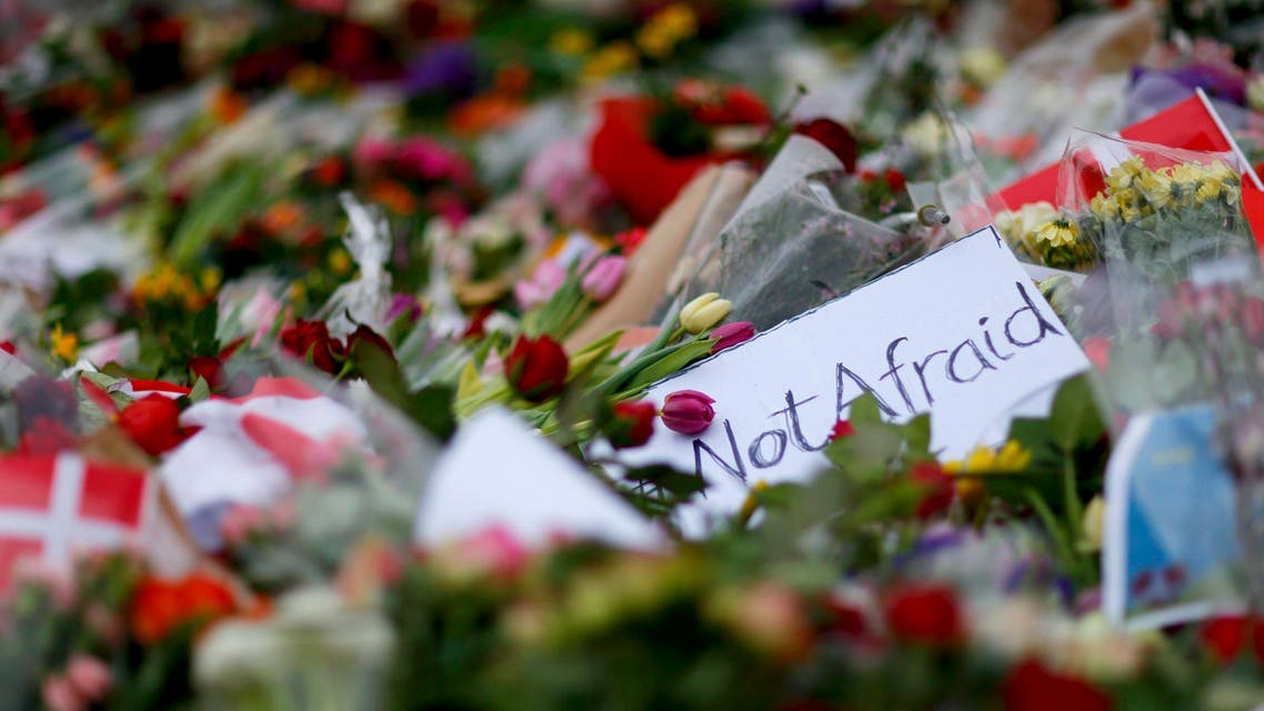Memorial flowers are placed in front of a cafe where a shooting took place in Copenhagen (Reuters)