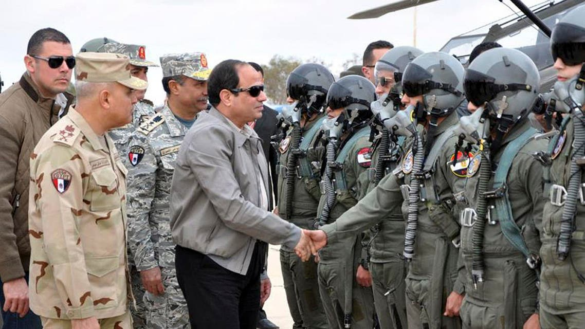 Egyptian President Abdel Fattah al-Sisi shakes hands with pilots and crews specialists of the Egyptian Air Force near the border between Egypt and Libya, in this February 18, 2015 handout courtesy of the Egyptian Defence Ministry. (Reuters)