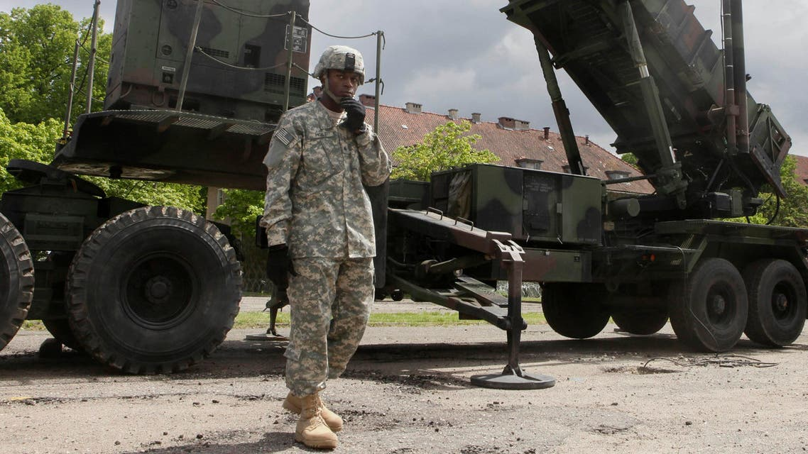 A U.S. soldier stands next to a Patriot surface-to-air missile battery at an army base in Morag, Poland. Turkey's government requested the deployment of NATO's Patriot surface-to-air missiles in 2012.(File Photo:AP)