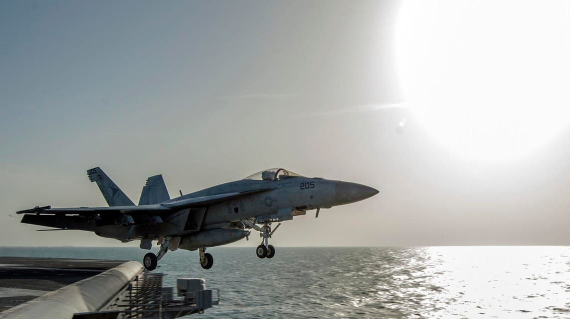 In this image released by the U.S. Navy on Friday, Dec. 5, 2014, a fighter jet launches from the flight deck of the Nimitz-class aircraft carrier USS Carl Vinson (CVN 70) as the ship conducts flight operations in the U.S. 5th Fleet area of operations supporting Operation Inherent Resolve targeting Islamic State militants in Iraq and Syria. (AP Photo