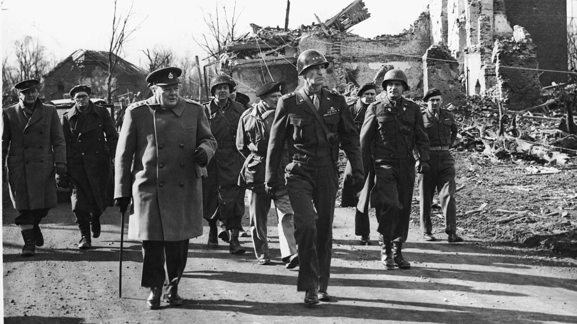 Prime Minister Winston Churchill of England with Gen. William Hood Simpson, Commander in Chief of the U.S. 9th Army, tour the ruins of Julich, Germany, on the Siegfried Line, March 7, 1945. (AP)