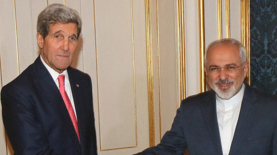 U.S. Secretary of State John Kerry shakes hands with Iranian Foreign Minister Mohammad Javad Zarif, right, prior to a bilateral meeting of the closed-door nuclear talks with Iran in Vienna, Austria, Sunday, Nov. 23, 2014. AP