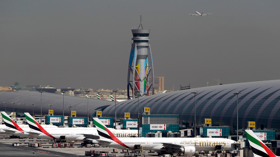 In this May 8, 2014 file photo, Emirates passenger planes are parked at their gates of Dubai airport in United Arab Emirates AP
