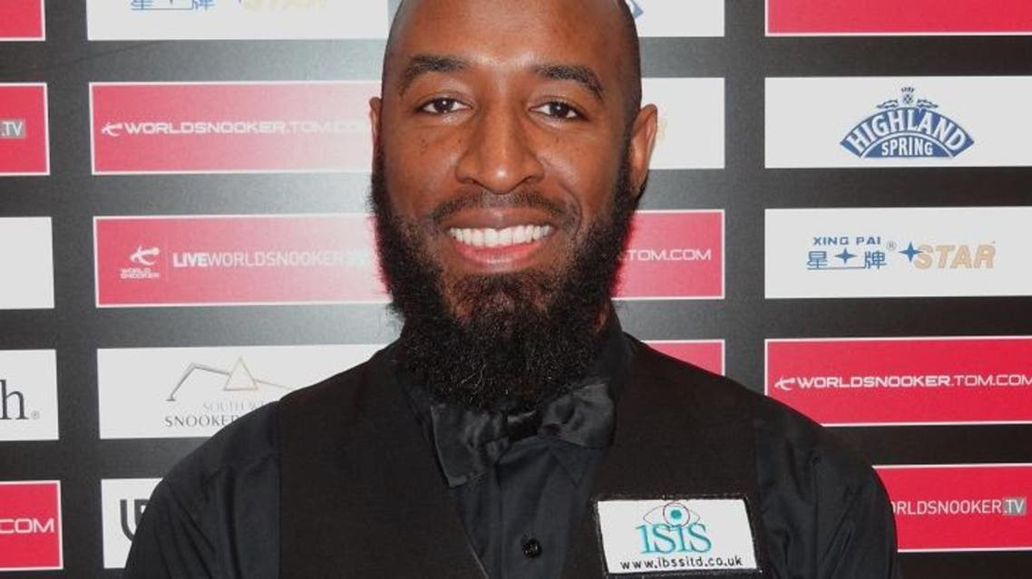 Rory McLeod posing with a badge bearing the name of his sponsors of 14 years, Isis Business Solutions, in 2011, long before the rise of ISIS. (Photo courtesy: www.maximumsnooker.com)