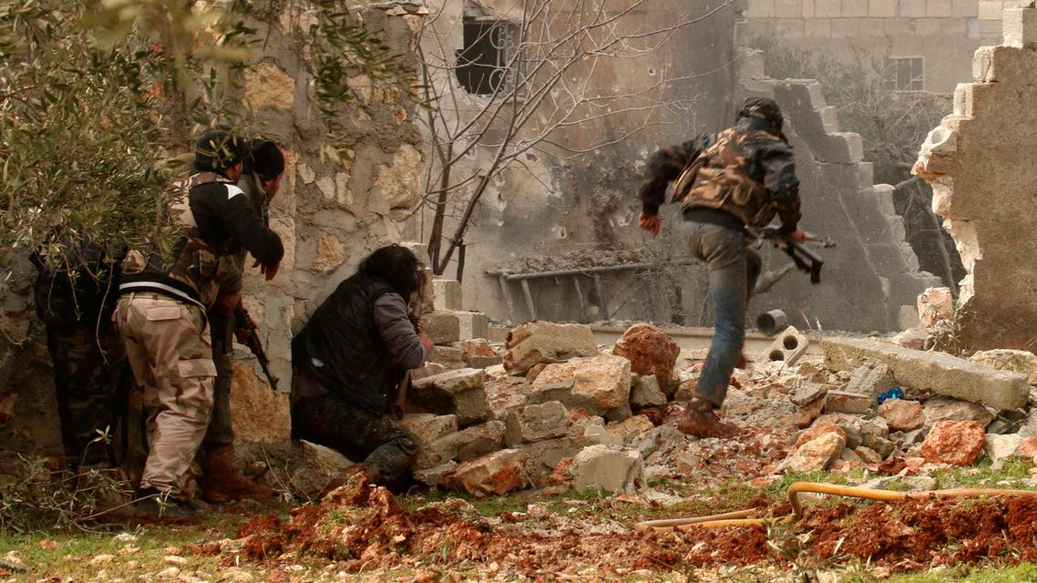 A rebel fighter carries his weapon as he runs while others take positions in Ratian village, north of Aleppo, after what the rebels said was an offensive against them by forces loyal to Syria's President Bashar al-Assad that attempted to advance in the village but failed to February 18, 2015.Reuters