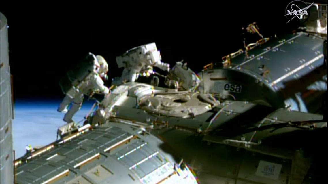 his February 21, 2015 NASA TV image shows NASA astronauts Barry Wilmore(L) and Terry Virts during a spacewalk to lay cable on the International Space Station. (AFP)