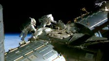 U.S. astronauts prepare spacewalk to lay cable at station