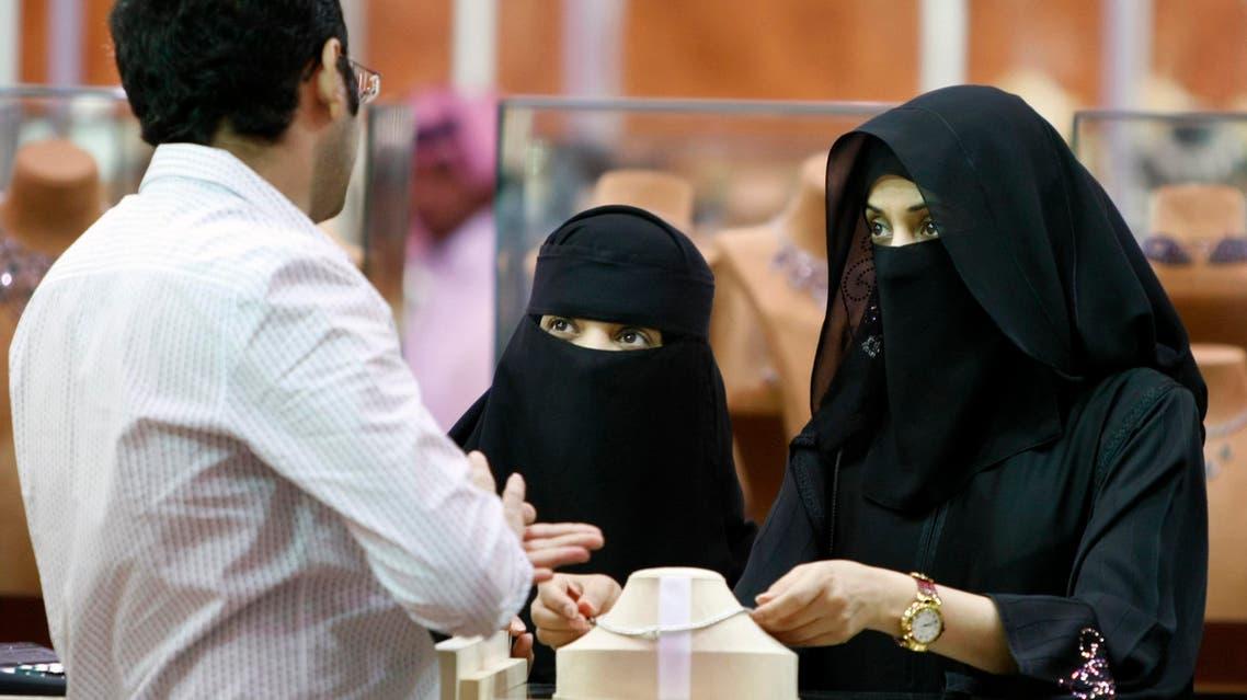 In this Saturday, March 21, 2009 file photo, Saudi women look at jewelry at a gold fair in Riyadh, Saudi Arabia. (AP)