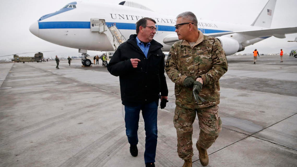 U.S. Secretary of Defense Ash Carter (L) walks with U.S. Army General John Campbell, who greeted him upon his arrival at Hamid Karzai International Airport in Kabul, Afghanistan February 21, 2015. (Reuters)