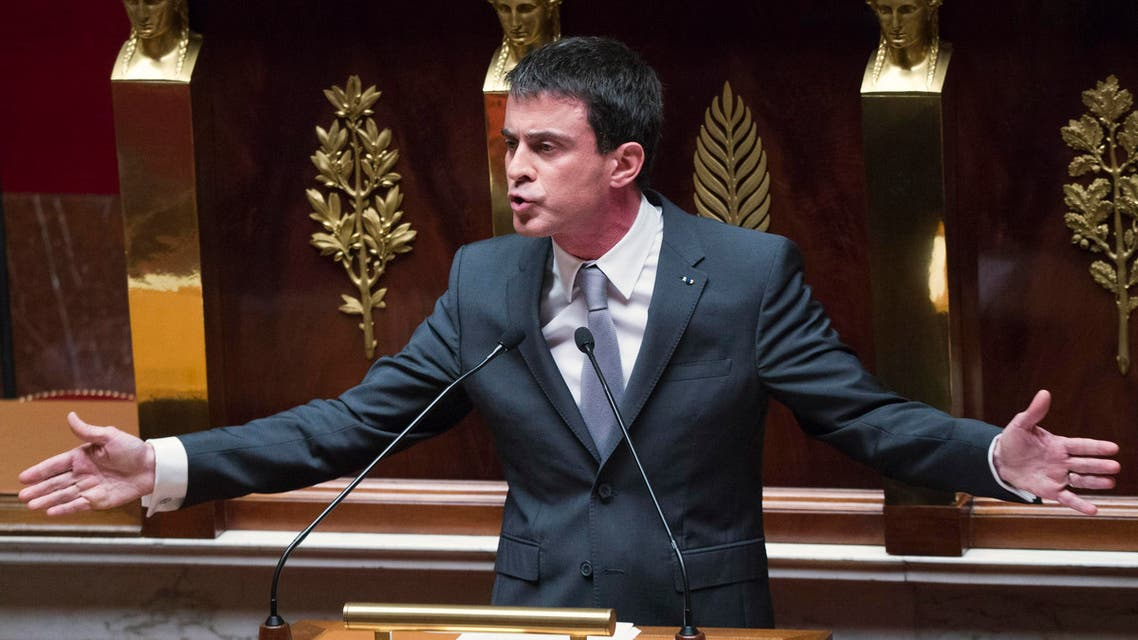 French Prime Minister Manuel Valls gestures as he speaks prior to a parliamentary vote of confidence over the government's economic reform at the French National Assembly, Paris, Thursday, Feb 19, 2015. AP