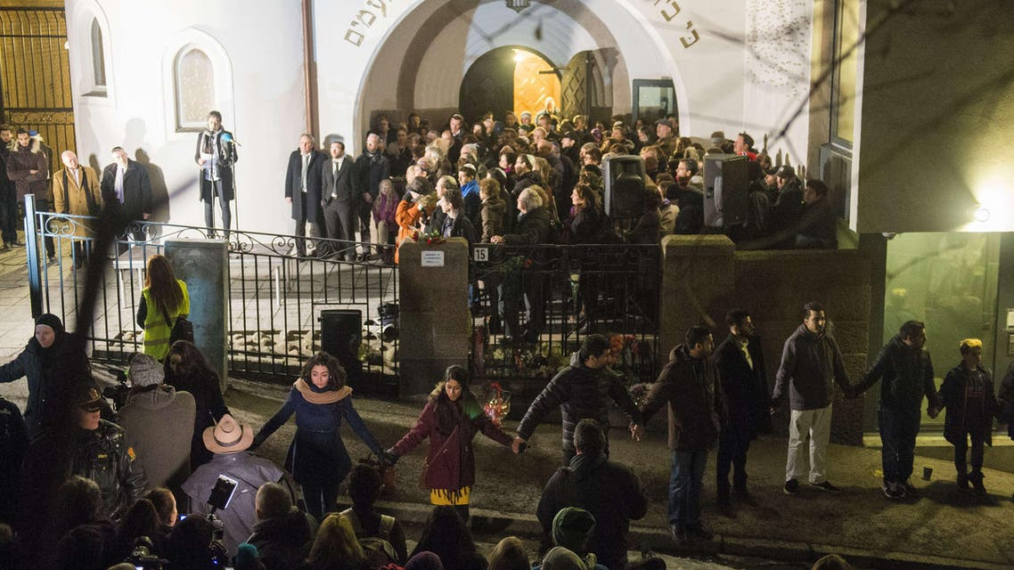 Norwegian Muslims create a human peace ring around the synagogue in Oslo, Norway on February 21, 2015. (Reuters)